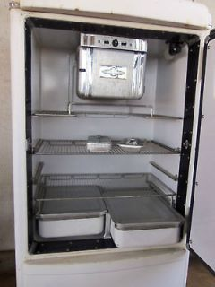 Old refridgerator made by General Motors , ice box antique