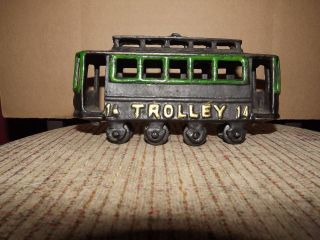VINTAGE CAST IRON TROLLEY CAR #14