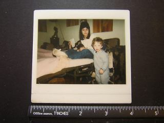 Modern Color Polaroid 0671 mom sits on hideaway bed w dog in lap & boy