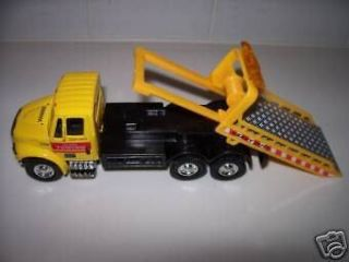 International Yellow Flatbed Tow Truck Functional Rollback 1/64 Scale