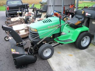 SABRE GARDEN TRACTOR BY JOHN DEERE W/ SNOW THROWER   SNOW BLOWER. RUNS