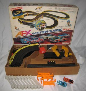 AURORA AFX HO SCALE RACE SET WITH TWO CARS IN ORIGINAL BOX WORKS