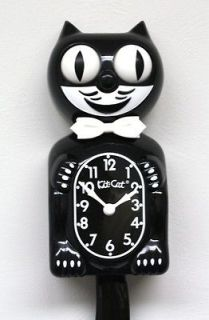 newly listed black kit cat clock  left