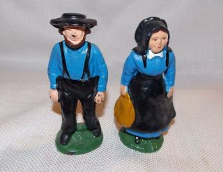 vintage painted cast iron amish man and woman figurines time