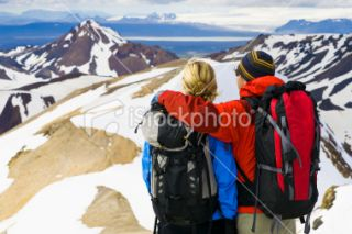 Rear view of man and woman hikers (mid 30s). Royalty Free Stock Photo