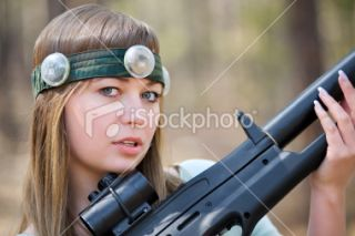 stock photo 14077853 girl with gun