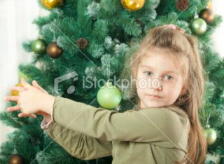 stock photo 18241945 little girl with christmas tree