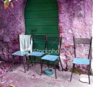 Purple House & 4 Chairs. Royalty Free Stock Photo
