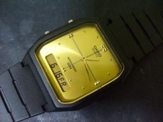 vintage casio analog digital dual time gold face watch from