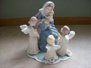 Treasures Porcelain  Mary With Baby Jesus And Angels Table Figurine