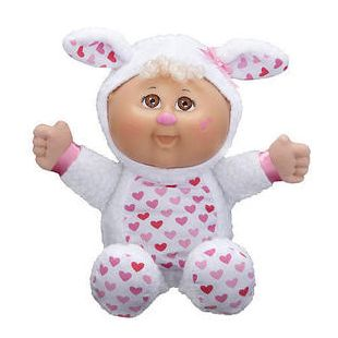 cabbage patch kids baby cuties white lamb doll is dressed in a white