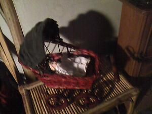 Vintage Wicker Doll Carriage with Porcelain Baby Doll