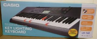 CASIO LK160 Electronic 61 Key Lighted Keyboard w/ Stand Light Up