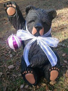 CHAINSAW CARVED SITTING BLACK BEAR CARVING WAVING / HOLDING ORNAMENT