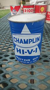 CHAMPLIN HI V I metal oil can used at gas station by visible gas pump