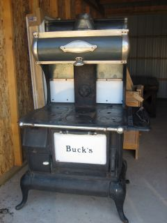 ANTIQUE WOOD COOK STOVE   BUCKS Manufactured in ST. LOUIS, MO.