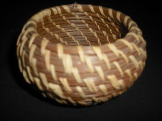 Vintage Coushatta Indian pine needle basket with original tag