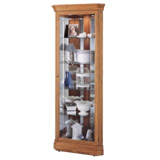 collectibles with pride in this Howard Miller, Hammond Corner Cabinet