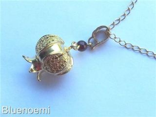Sterling silver gold plated pomegranate necklace with a garnet