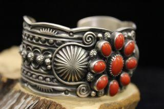 Sterling Silver Bracelet w 9 Coral Cab Stones by Delbert Gordon