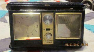 VINTAGE ELECTRO BRAND PORTABLE CLOCK RADIO  GENUINE LEATHER CASE