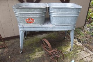 VINTAGE GALVANIZED WHEELING DOUBLE WASH TUBS AND WHEELING WASH STAND