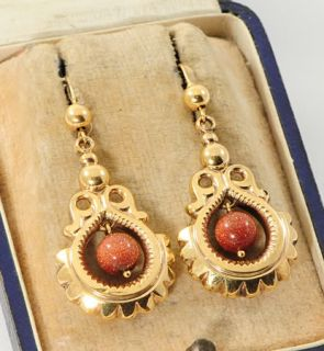 Drop earrings with a goldstone bead made in 9 carat gold and dating to