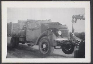 Photo 1937 International Truck Wreck on Tow Hook 660521