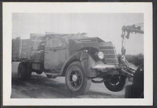 Photo 1937 International Truck Wreck on Tow Hook 660521