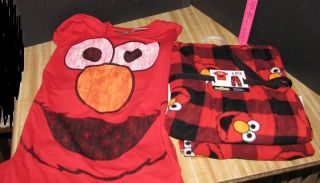 Up for auction is a NEW Sesame Street ELMO Fleece Pajama pants & Top