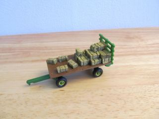 1 64th Ertl John Deere Hay rack wagon with bale load neat one here