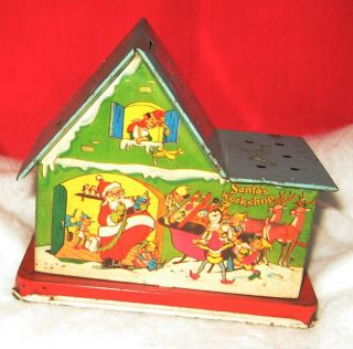 Vintage Tin Santas Workshop Lollipop Holder House Bank Litho US Metal