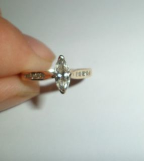 Beautiful Marquise diamond engagement ring with accents on the band