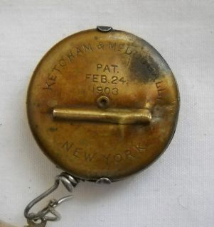 1903 Vintage Ketcham McDougall Chain and Reel Pin Golden Wheel Lighter