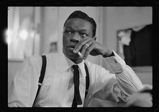 Nat King Cole smoking cigarette,jazz pianist,singer ,big band,musician