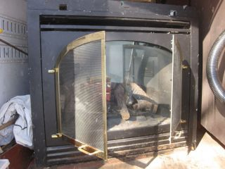 Heat N Glo main fireplace/corner fireplace     Heat N Glo wood