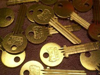 TWENTY FIVE KEY BLANKS FIT MEDECO LOCKS