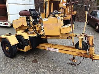 Rayco RG1625 self propelled stump grinder with rayco trailer